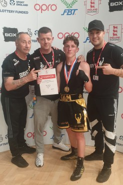 Sam with his coaches and cornermen